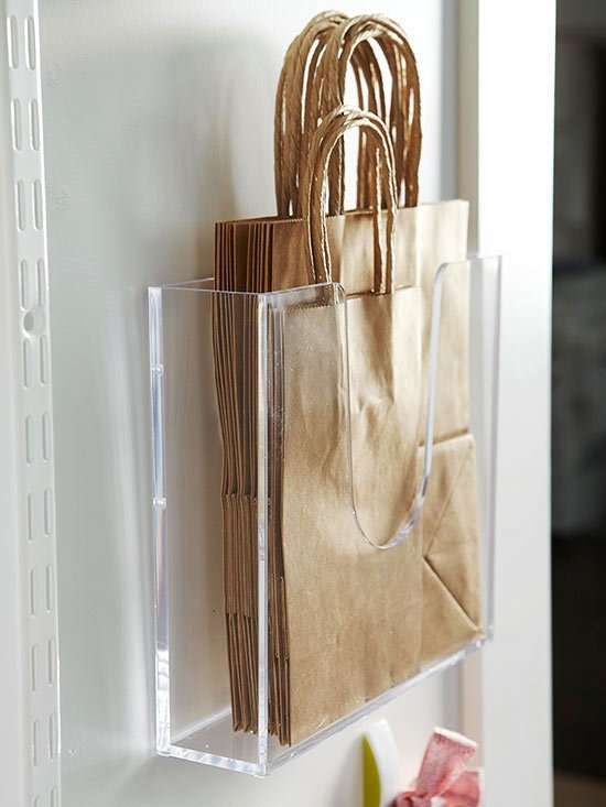 These transparent plastic magazine holders are great for storing paper bags.
