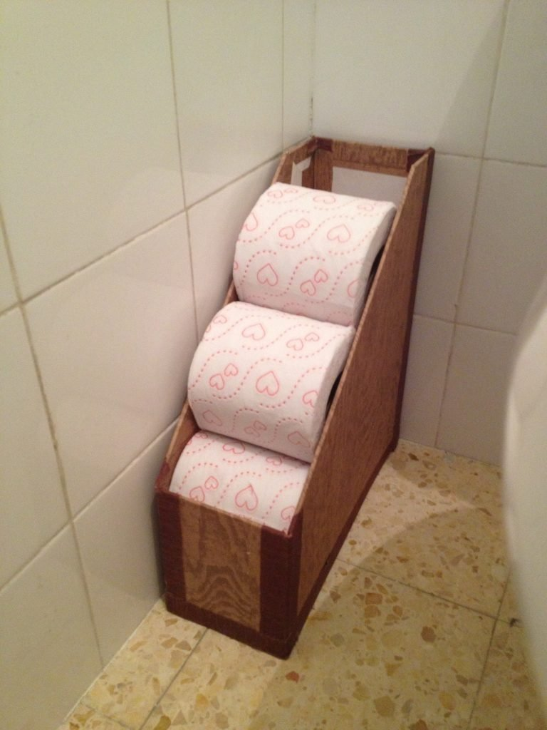 This magazine holder is the perfect toilet paper storage.