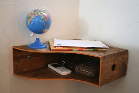This wood magazine holder is a great nook to store items on the go.
