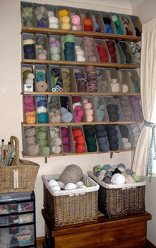This wall of magazine holders is great for organizing various colors of yarn.