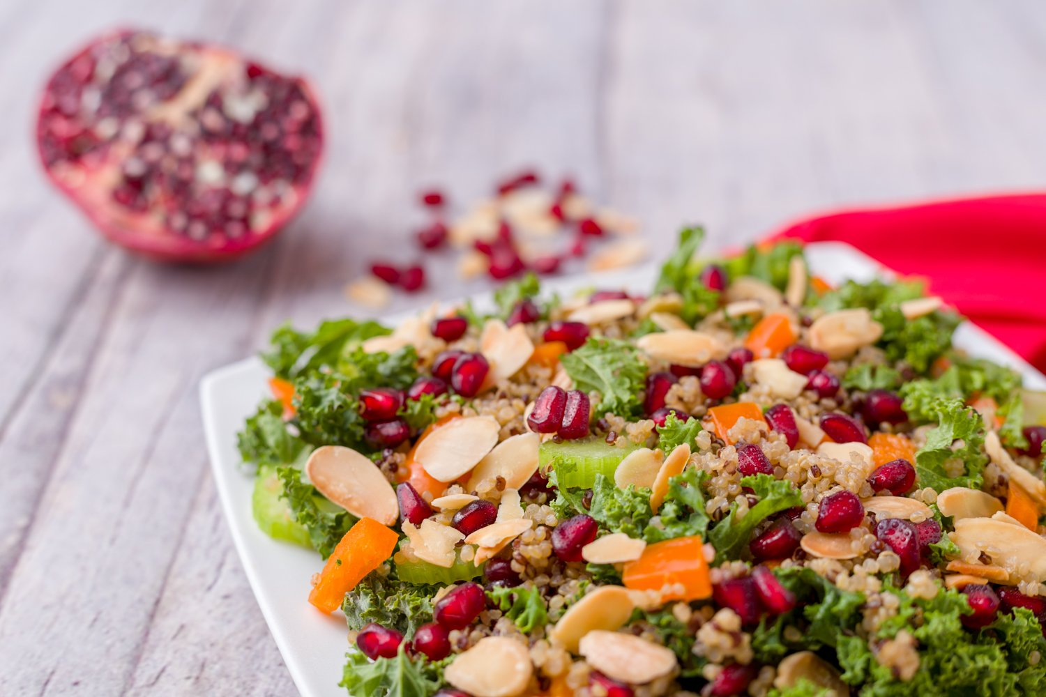 Don't sacrifice taste for healthy eating. Check out this Kale Quinoa Pomegranate Salad recipe that even the kids will love. #healthyeating #kale