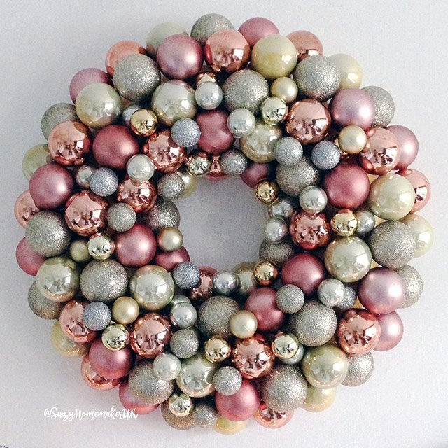 This beautiful DIY bauble wreath is easy to make and can be customized to fit any decor and will look fabulous in every season. #christmas #christmaswreath #baublewreath #DIY #crafts