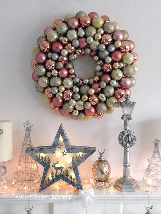 You will love how easy it is to make this beautiful DIY Christmas Bauble Wreath. It is the ultimate statement piece for your mantle or front door decor for the holidays. It can be customized to suit any colour palette. Make one for every season! #christmas #christmaswreath #baublewreath #DIY #crafts