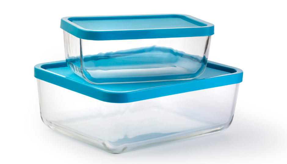 Do your kitchen cupboards or drawers spill food containers and lids all over when you open them? Here are 7 space saving tupperware storage ideas that will tame even the largest plastic food container collection! Click through to check out these hacks. #organization #kitchen #tupperware