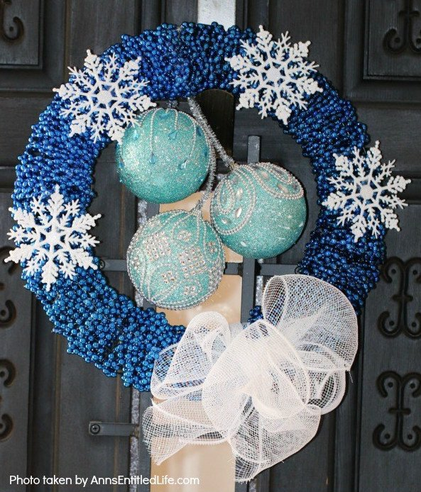 Make your home look festive and add a cute DIY Dollar Store Christmas wreath to your front door. If you are looking for a cheap and budget friendly DIY Christmas wreath idea then I have your covered. #DIY #christmas #wreaths #dolarstoredecor #budgetdecor