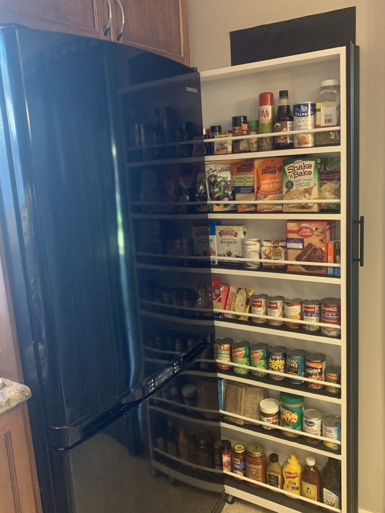 Not all kitchens have a pantry but if you have a small vertical space, you can make this DIY slide out pantry organizer using this tutorial. It holds so much stuff!