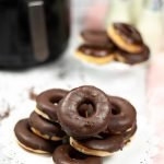This copycat Krispy Kreme donut recipe is finger licking good. Whip up these air fryer yeast donuts, and skip frying the donuts in oil.
