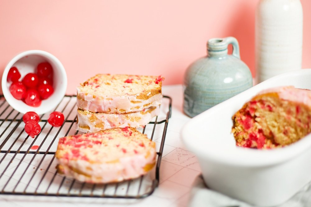 Cherry bread is a super easy and moist cherry quick bread that is bursting with sweet fruit flavor. The cherry glaze on top adds the perfect sweetness to the cherry loaf bread.